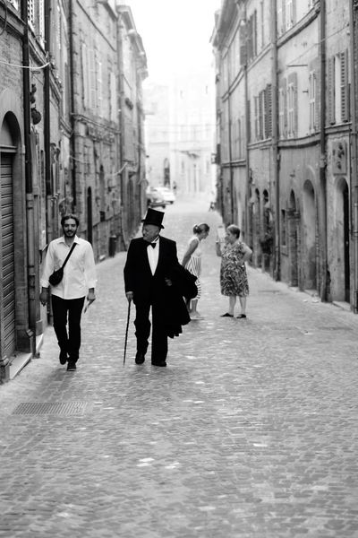 Streets of italy 🇮🇹 Streetphotography Lastrada Italy Italia Streets Culture Architecture Full Length Men Women Day Real People People Petritoli Vacation Magic Moments Dolcevita  Amore Be. Ready. Black And White Friday