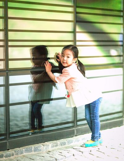 Reflection Of Girl On Glass