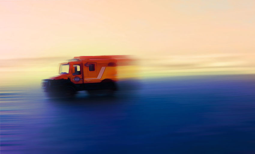Artistic edit of moving van Motion Blur Moving Van Racing Art Car Day Mode Of Transport Motion Moving Car Nature No People Oil Painting Outdoors Painting Racing Car Red Sea Sky Sunset Transportation Truck Van AI Now