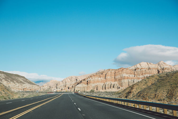 Beauty In Nature Day Landscape Mountain Mountain Range Nature No People Outdoors Road Road Marking Scenics Sky The Way Forward Tranquil Scene Tranquility Transportation White Line