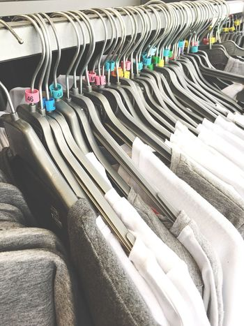 Large Group Of Objects In A Row No People Variation Indoors  Day Fashion Clothes Rack Hanging Clothing Coathanger Retail  Boutique Market