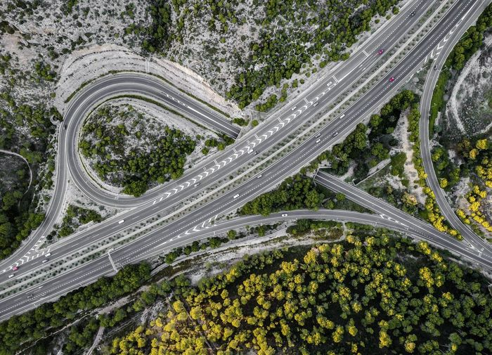 Aerial View Of Highway Amidst Forest