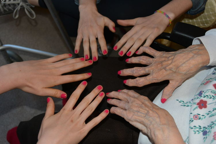 Love Bonding Day Fingernail Friendship Great-aunt And Nieces High Angle View Human Body Part Human Finger Human Hand Indoors  Leisure Activity Lifestyles Nail Polish Real People Red Special Moments Togetherness Touching Women Young And Old