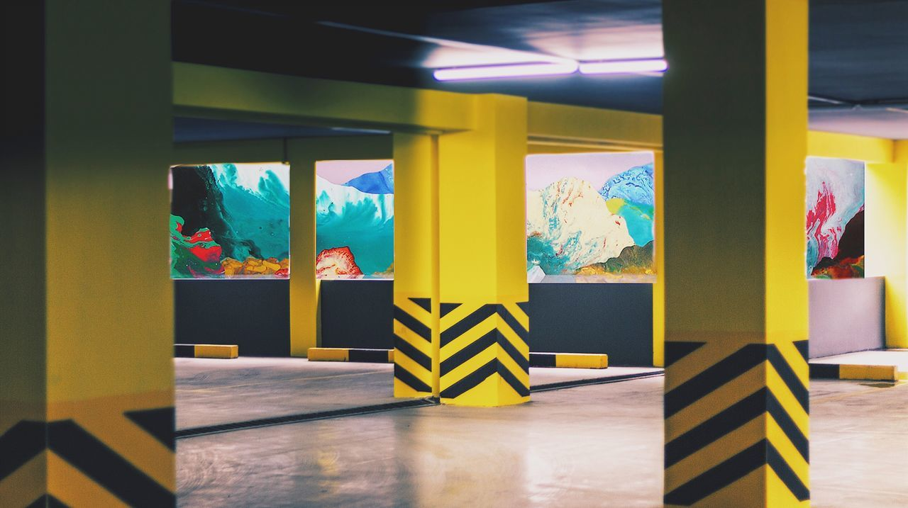 indoors, multi colored, in a row, no people, architectural column, yellow, day, architecture
