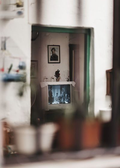 Architecture Art And Craft Belief Built Structure Day Frame Glass - Material Human Representation Indoors  No People Photography Themes Picture Frame Reflection Religion Representation Selective Focus Spirituality Still Life