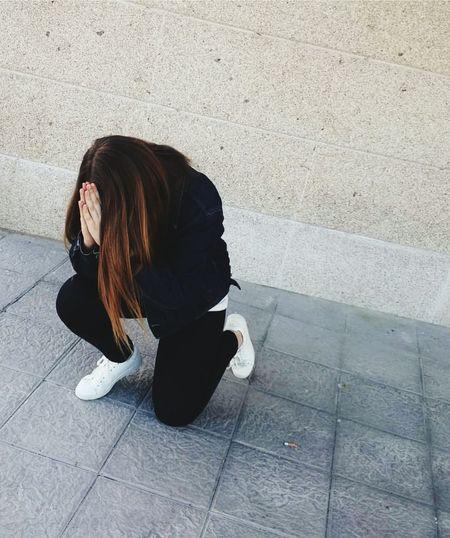 Woman Praying On Footpath
