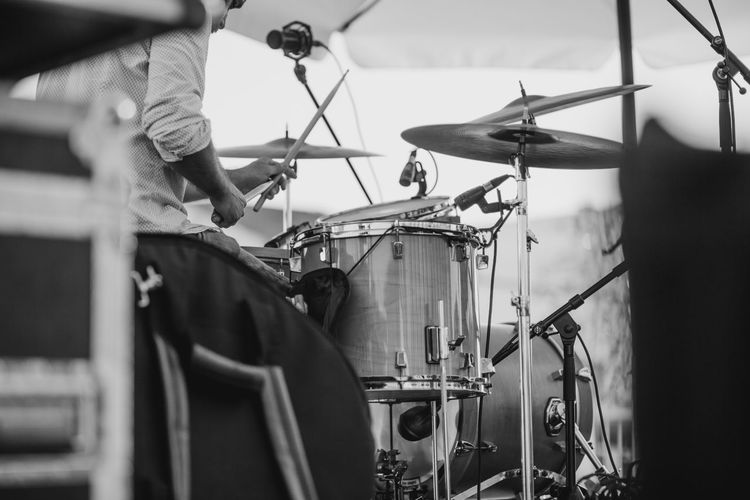 Midsection Of Man Playing Drum Set
