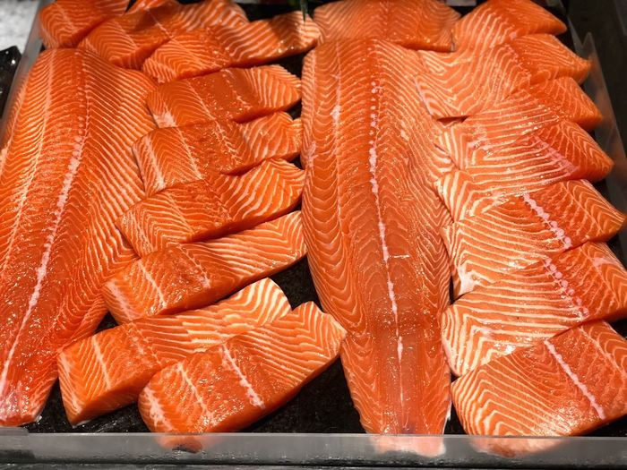 Fresh salmon fish Food Food And Drink Freshness Healthy Eating Orange Color Wellbeing Seafood No People Still Life Close-up Fish Indoors  SLICE Large Group Of Objects Raw Food Retail  Abundance Table For Sale High Angle View