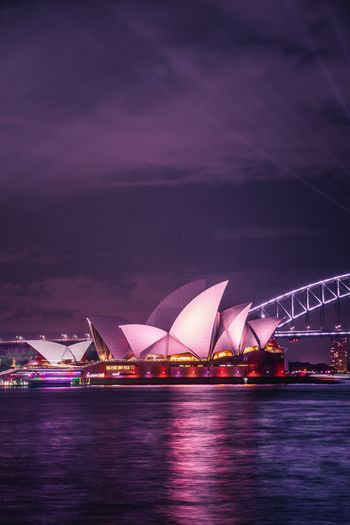 Sydney Opera House Landscape Sydney Opera House Australia Sydney Architecture Night Travel Destinations Building Exterior City Water Built Structure Illuminated Arts Culture And Entertainment Waterfront Travel No People Tourism Outdoors Purple Cityscape Nightlife Sky The Traveler - 2018 EyeEm Awards The Architect - 2018 EyeEm Awards