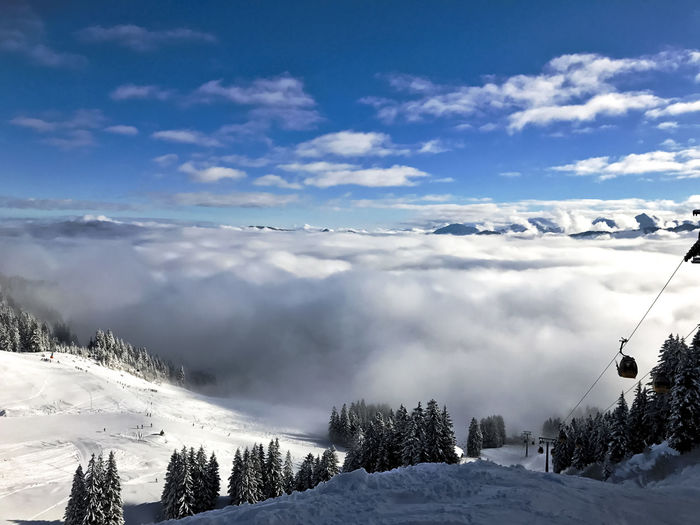scenic view of snow covered mountains over heaven Fun Gondola Perspectives On Nature Slopes Beauty In Nature Cloud - Sky Cold Temperature Day Landscape Mountain Nature No People Outdoors Scenics Ski Lift Skier Sky Snow Tranquil Scene Tranquility Tree Vacation Weather Winter