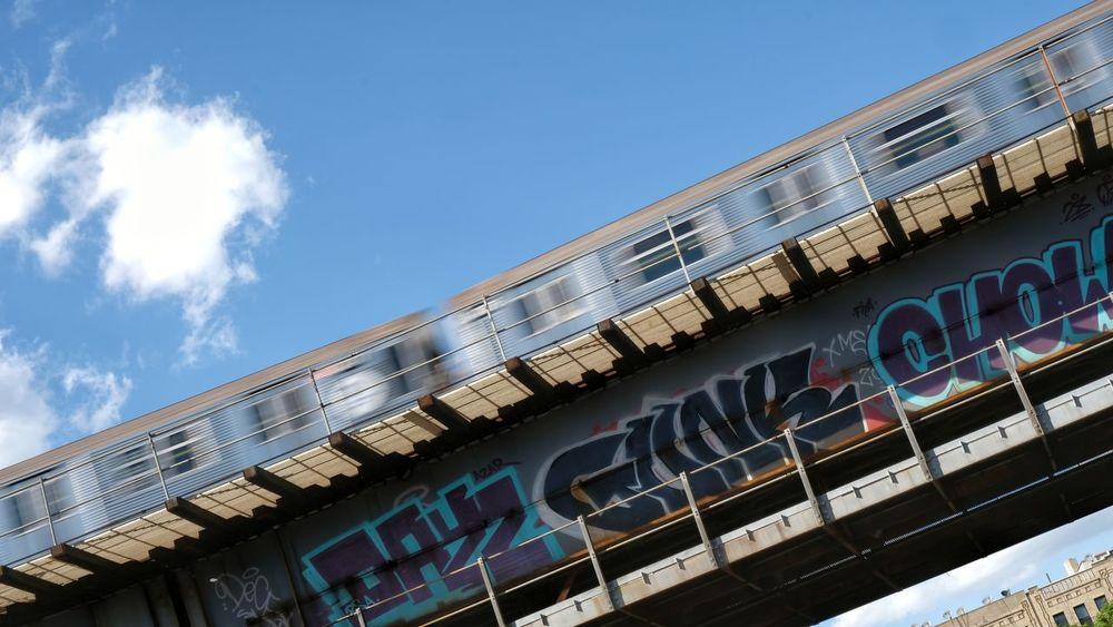 Moving the cattle. Motion Fuji Xt20 Slow Shutter Speed Transportation Train Graffiti Sky And Clouds Photography Sunlight And Shadow Outdoors Elevated Train Tracks City Sky Built Structure Spray Paint Street Art Vandalism