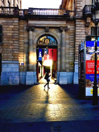 Man walking in illuminated city