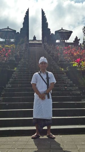 Man in white Balinesse Traditional Clothes Standing Man In Front Of The Temple Stairs To The Temple Balinesse Tranquility Proud To Be Balinesse Monochrome Photography