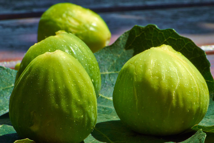 Close-Up Of Figs On Leaf
