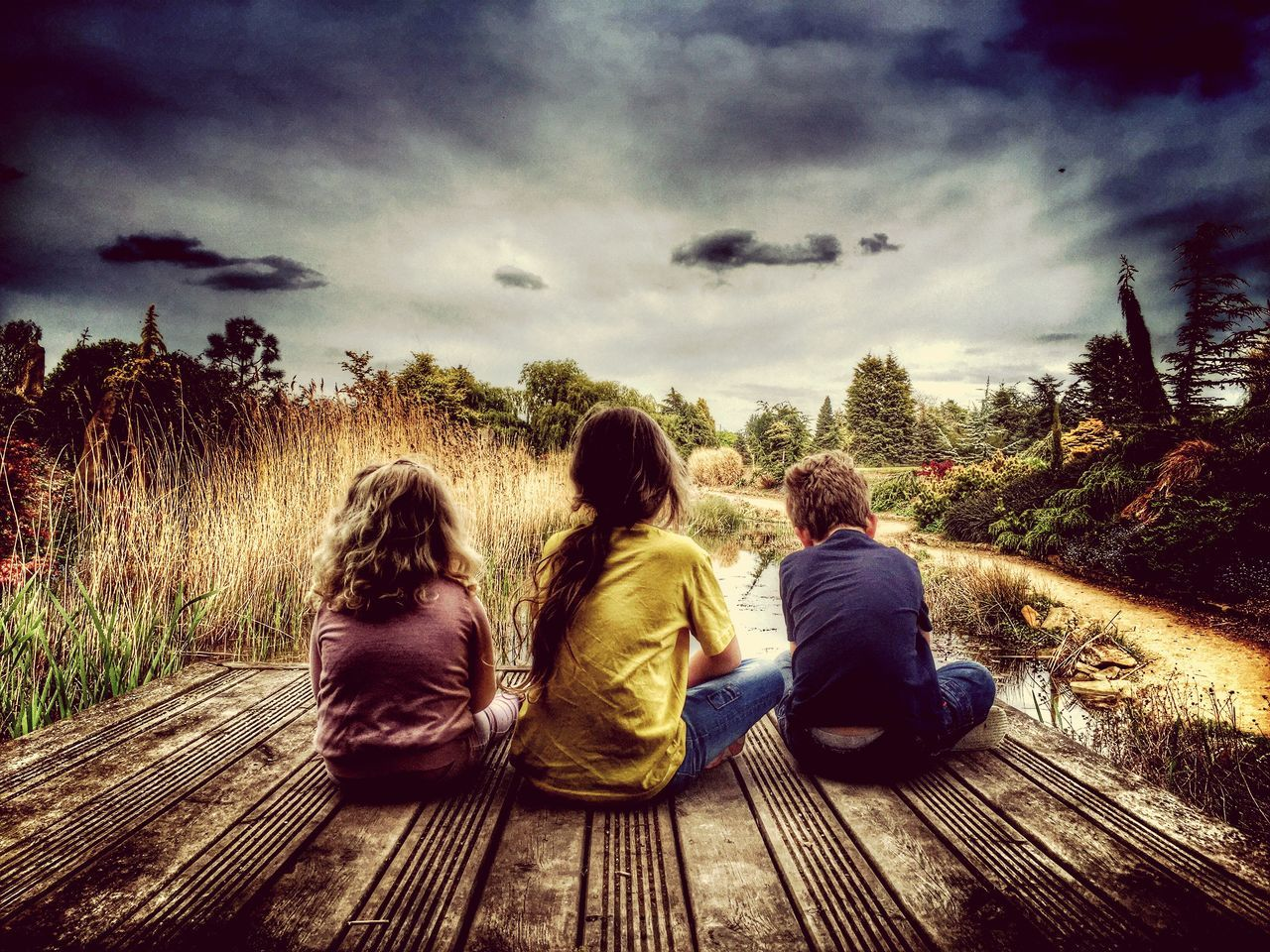 sky, rear view, sitting, cloud - sky, plant, tree, togetherness, leisure activity, women, child, real people, nature, lifestyles, family, men, childhood, boys, group of people, girls, friendship, sister, outdoors, looking at view