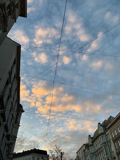 Cloudy sky in evening light over a city Cables Pastel Colored Pastel Historical Building City Urban Cloud - Sky Sky No People Sunset
