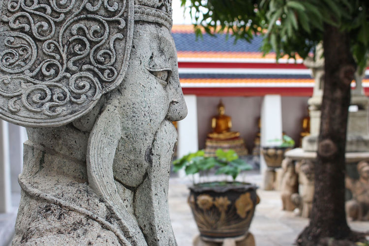 Wat Pho, Bangkok, Thailand - Mar. 15, 2017: The closeup image of Statue of ancient commander at Wat Pho, Bangkok, Thailand. Buddhism Buddha Sacred Old Stone Travel Destinations Travel Ancient Urban History Bangkok Thailand Temple - Building Temple Wat Pho Guardian Lucky Dog Komainu Commando Ornate Outdoors Focus On Foreground Human Representation Place Of Worship Day Craft Building Belief No People Spirituality Religion Statue Creativity Sculpture Representation Built Structure Art And Craft Architecture