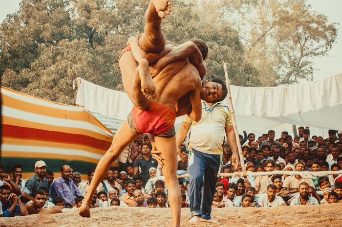 Dangal, also known as Kushti, is an Indian form of wrestling played in mud. It is still popular form of entertainment and spoort in smaller towns and villages in India. Pictured here is a local competition held in a popular fair in Deva, Barabanki, India. Dangal India Indian Wrestling Kushti Sports Street Photography Streetphotography The Street Photographer - 2017 EyeEm Awards Wrestling Mix Yourself A Good Time Done That. Been There. Summer Sports