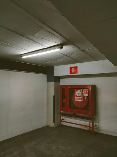 Empty parking lot with text on wall in subway