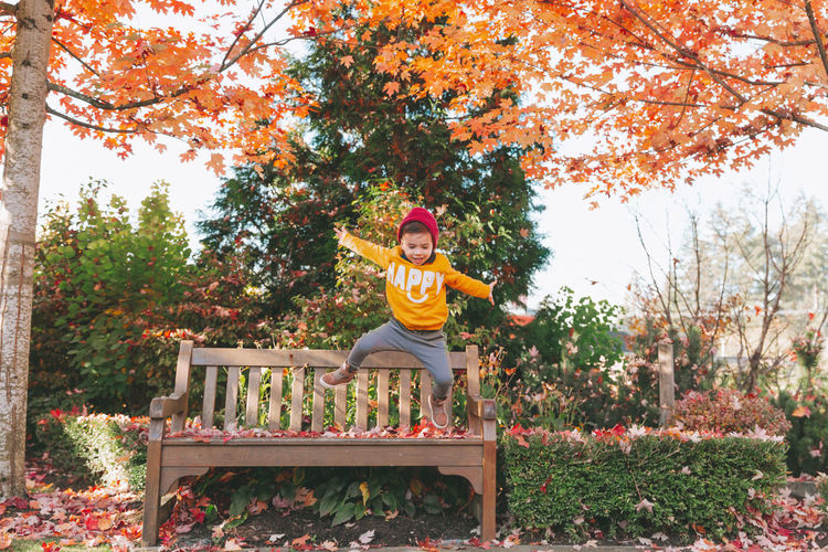 Full Length Of Boy Jumping At Park During Autumn