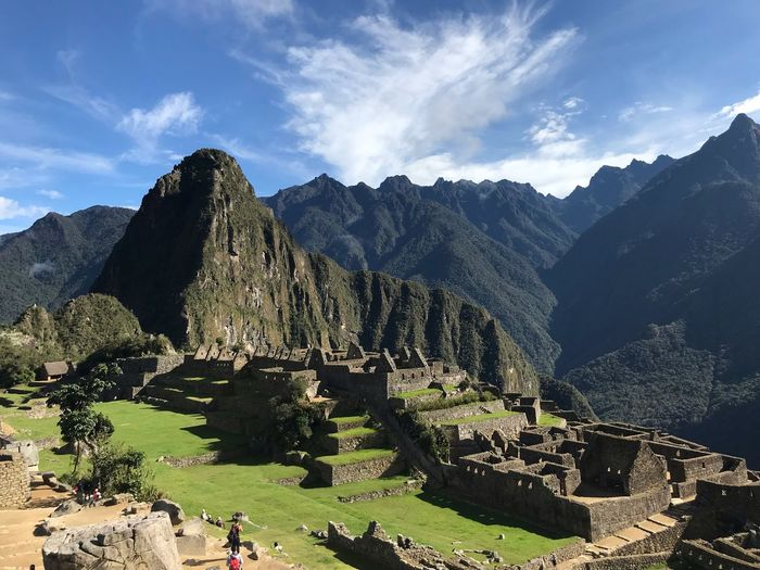 Panoramic view of ruins of mountains against cloudy sky