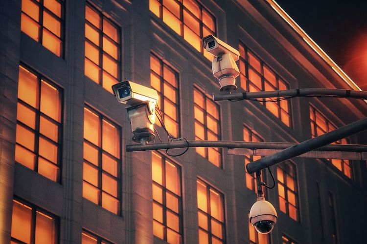 Low Angle View Of Security Cameras Against Building