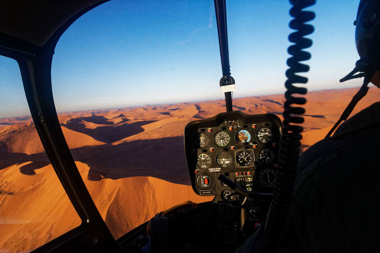 A new day, a new adventure; take off at sunrise in a chopper to fly over the dunes. Sossusvlei Desert - Namibia Air Vehicle Airplane Chopper Close-up Cockpit Control Panel Day Flying Gauge Indoors  Landscape Mountain No People Pilot Sky Technology Transportation Vehicle Interior Window The Photojournalist - 2018 EyeEm Awards