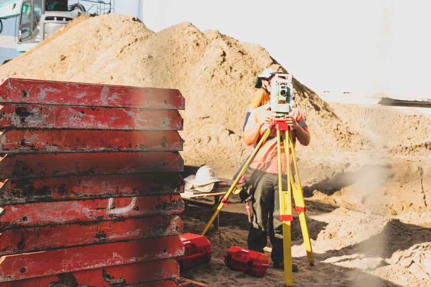 Building Site Construction Construction Site Industry Occupation One Person Outdoors Sand Surveyor Working Break The Mold