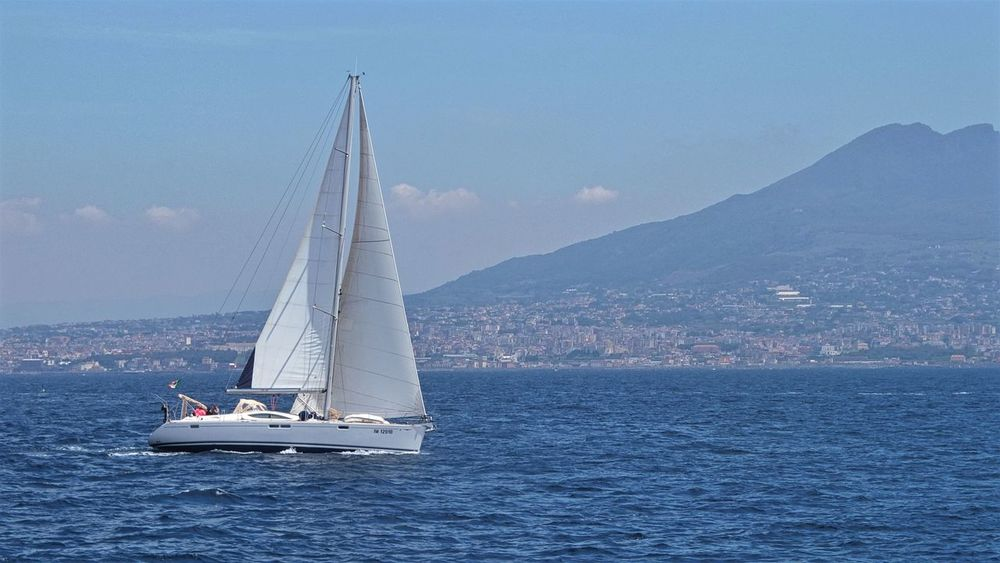Boat Day Daylight Distant Journey Marine Mast Mediterranean  Mountain Nature Nautical Vessel Outdoors Pleasure Sailboat Sailing Sea Seascape Sky Tourism Transportation Feel The Journey Vesuvio Water White Yacht