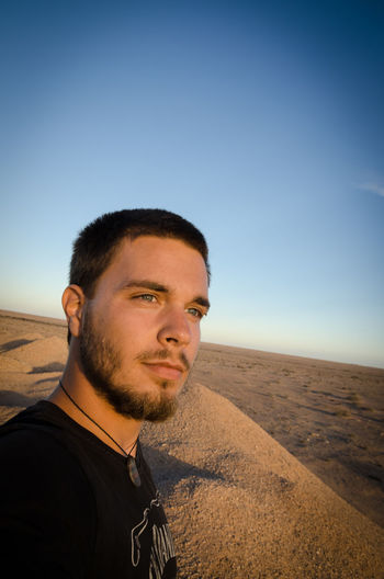 Close-Up Of Smiling Young Man At Desert