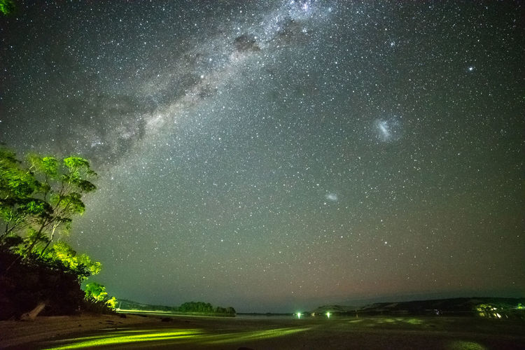 Milky Way and red airglow Galactic Core Large Magellanic Cloud Small Magellanic Cloud Airglow Astronomy Beauty In Nature Galaxy Lagoon Landscape Milky Way Nature Night No People Outdoors Plant Scenics - Nature Sky Southern Hemisphere Space Star - Space Starry Night Tranquil Scene Tranquility Transportation Tree