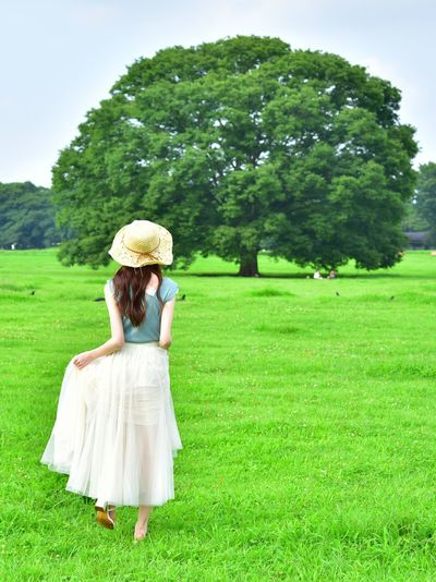 Rear view of woman on grassy field