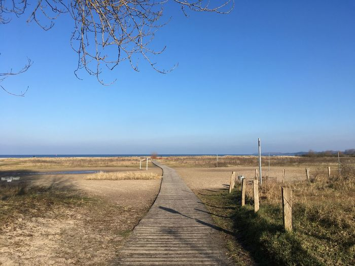 Weite am Strand Footpath Seascape Sea And Sky Clear Sky Tranquil Scene Nature Scenics Blue Tranquility Beauty In Nature Copy Space Day Outdoors Landscape No People Sky