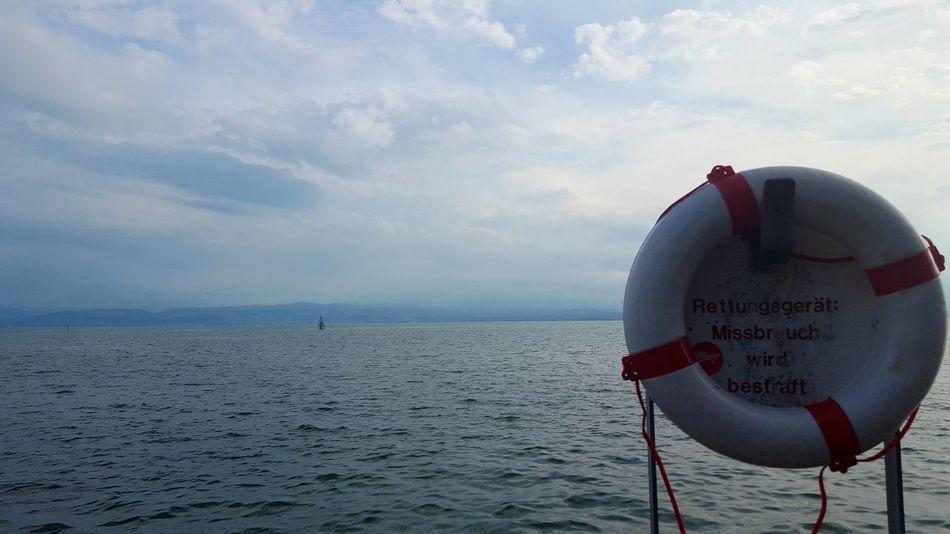 Save Looking Sea Horizon Over Water Water Beach Cloud - Sky Sky Outdoors Day Lifebelt Baywatch Rettungsring Rettungsschwimmer Friedrichshafen Lifeguard  EyeEm Best Shots