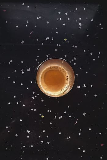 Close-up of coffee over black background