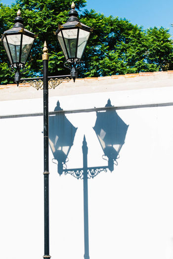 Shadow of the lamp post Blue Sky Day Lamp Post No People No People, Outdoors Shadow Sky Sunlight White Color