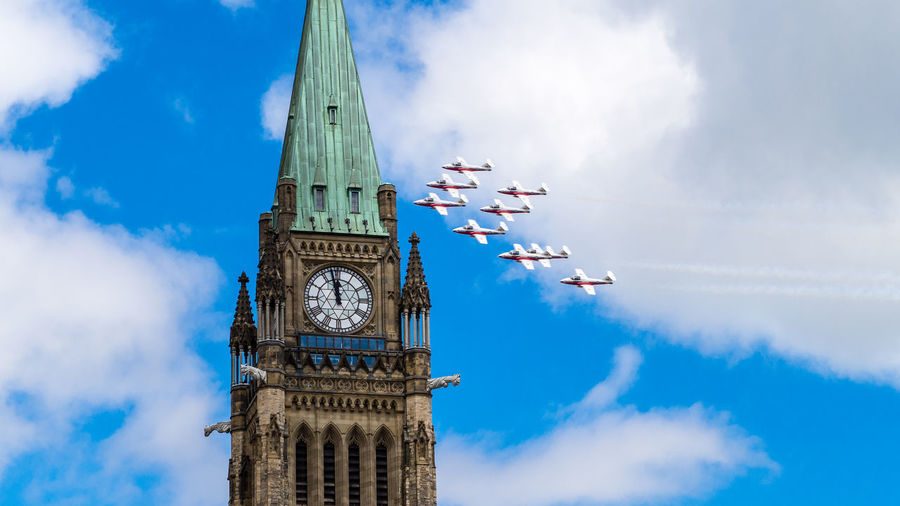 Royal Canadian Air Force flypast Parliament House on Canada Day, Ottawa, Canada Sky Cloud - Sky Low Angle View Day No People Outdoors Event Ceremony Canada Canada Day Ottawa Military Military Airplane Summer Summertime July Aerobatics Aerospace Industry Formation Formation Flying Blue Blue Sky Architecture Parliament Building Parliament Light Daylight Sunlight Airplane Air Vehicle Aircraft Aircraft Wing Speed Flag Canadian Flag Building Exterior Built Structure Tower Clock Tower Time Building Travel Destinations Clock City Tall - High Travel Teamwork Smoke Colors Beauty