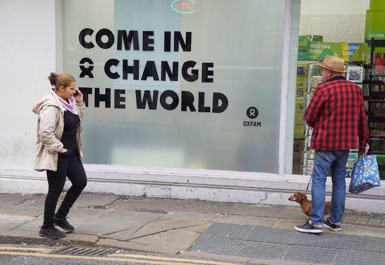 Full length of people walking on street in city