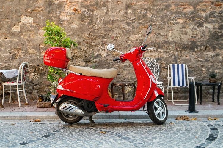 Red moped. Bike Street Red TakeoverContrast Roadside Outdoors Getting Inspired Streetphotography Colors City Life EyeEm Gallery Open Edit VSCO Street Photography Shootermag Red Traveling Moped