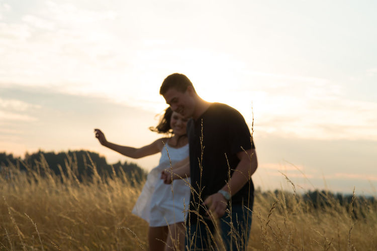 Young couple in love, running in field Couple Field Joyful Love Relationship Romance Romantic Running Adore Sunset Togetherness Young Love Young Lovers First Eyeem Photo
