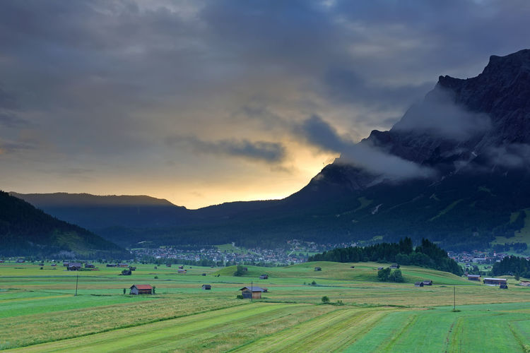 Summer of very large farm with the village and Mt. Zugspitze on the sunrise with fog , Ehrwald, Wetterstein mountain range at Biberwier, Tyrol, Austria Sky Beauty In Nature Scenics - Nature Landscape Tranquil Scene Environment Mountain Cloud - Sky Land Tranquility Nature Green Color Field Plant Grass Non-urban Scene No People Rural Scene Mountain Range Idyllic Outdoors Alps Austria Europe