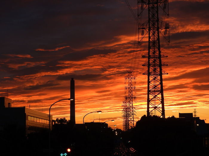 Architecture Built Structure Cable Cloud - Sky Connection Day Dramatic Sky Electricity  Electricity Pylon Fuel And Power Generation Low Angle View Nature No People Orange Color Outdoors Power Line  Power Supply Silhouette Sky Sunset Technology The Flame Of The Setting Sun Tree