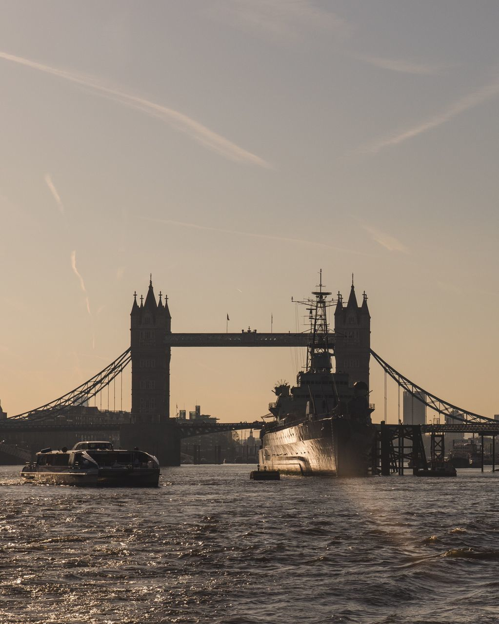 Silhoette Of Tower Bridge Over River At Sunset