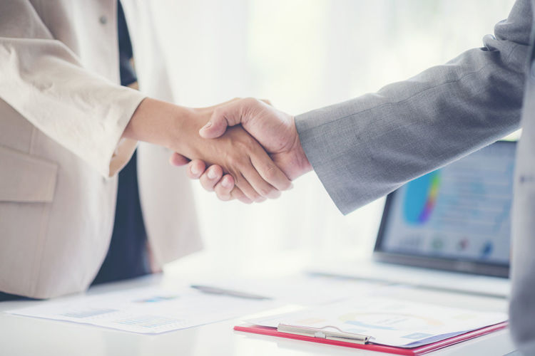 Close-up of business people shaking hands