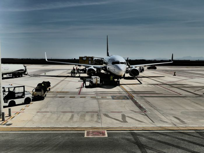 The wait EyeEm Selects Transportation Airplane Airport Air Vehicle Airport Runway Mode Of Transportation Military Cloud - Sky Outdoors Air Force Shipping  Army Navy Road Sky Day Incidental People Nature Aerospace Industry Asphalt My Best Photo
