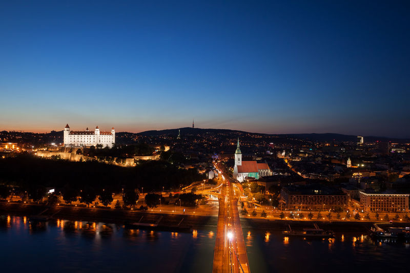 Bratislava in Slovakia at night, view over the capital city at Danube river. Bratislava Slovakia River Danube River Night Building Exterior Architecture Built Structure City Illuminated Travel Destinations Cityscape Copy Space Building Water Clear Sky City Lights Dusk Evening Twilight Urban Landscape Aerial View Capital Cities