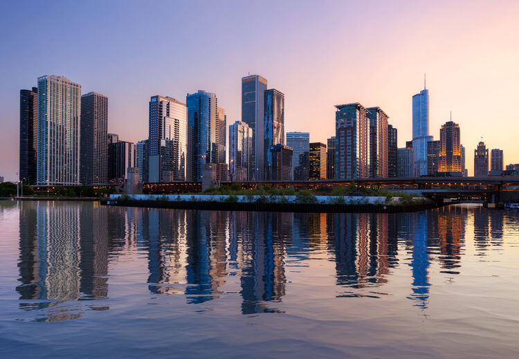 City skyline of Chicago with an artificial reflection added to the water in the lake to enhance the cityscape Chicago Chicago Skyline City Cityscape Illinois Lake Michigan Reflection Skyline Travel Architecture Building Building Exterior Dusk Financial District  No People Reflection Skyscraper Sunset Travel Destinations Water Waterfront