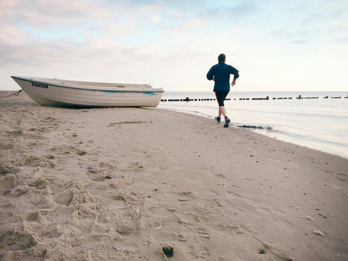 Morning run... Sports Running Jogging Baltic Sea Beach Open Edit Freedom Sand Boat Fisherboat My Best Photo 2015 Alternative Fitness Learn & Shoot: Simplicity Up Close Street Photography TCPM Live For The Story