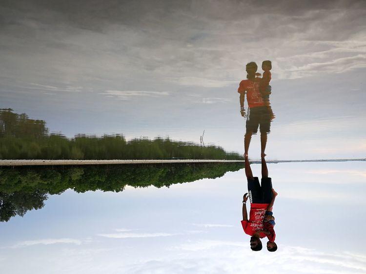 Reflection Cloud - Sky Men People Outdoors Boys Water Mirror Mirroreffect Sea And Sky Nature Cloudscape Seascape Morib Morib Beach, Malaysia