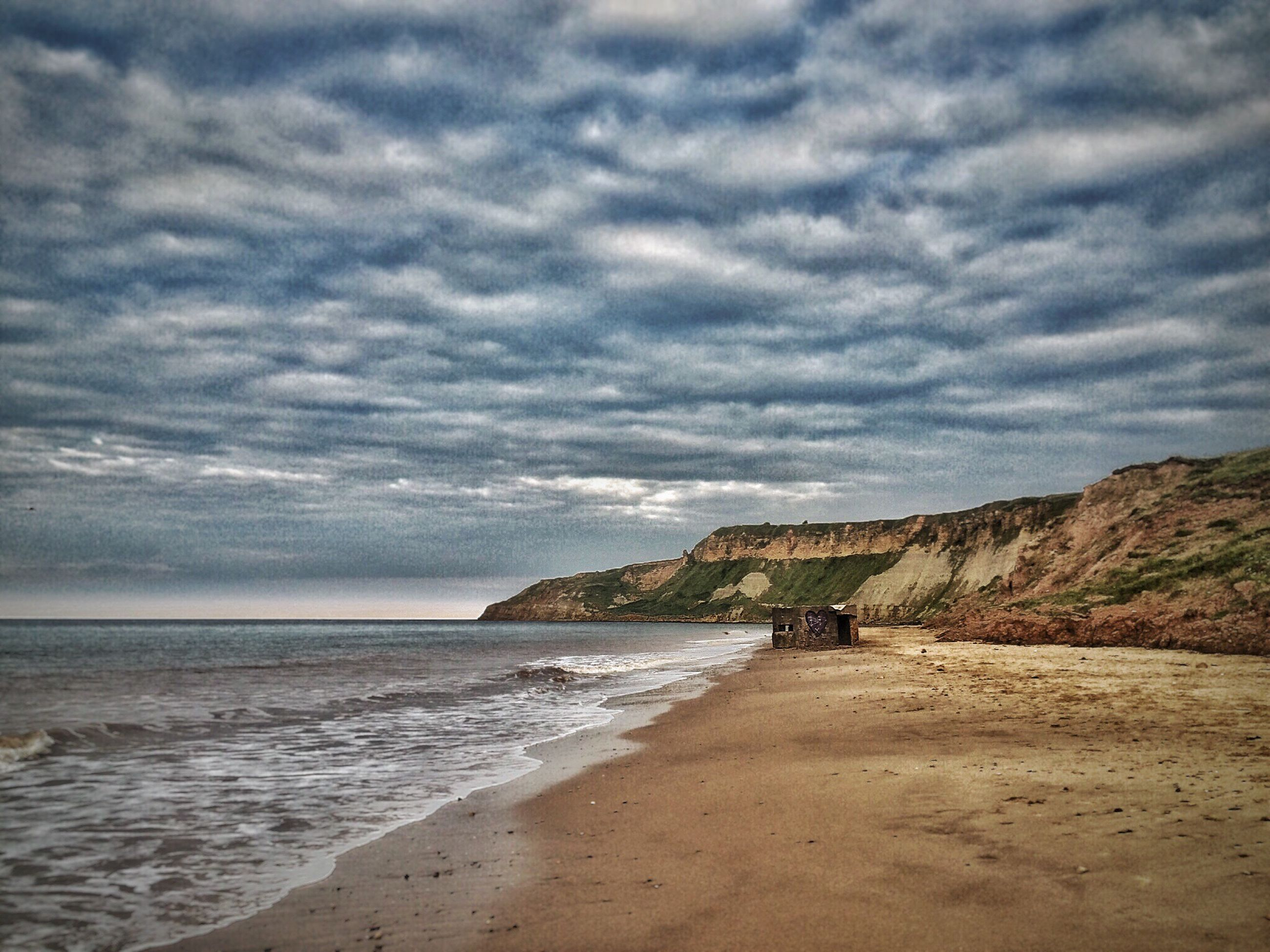 sea, water, sky, beach, horizon over water, cloud - sky, cloudy, shore, built structure, scenics, tranquil scene, tranquility, beauty in nature, cloud, nature, overcast, coastline, weather, idyllic, outdoors, day, calm, remote, no people, non-urban scene, dramatic sky, ocean, travel destinations
